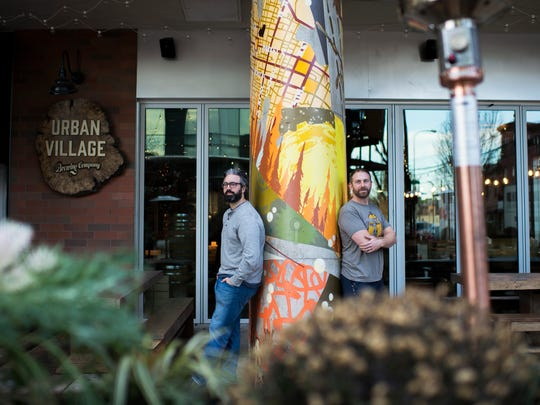 Owners Tom Revelli (left) and Dave Goldman hang out in the beer garden at Urban Village Brewing Company in Philadelphia.