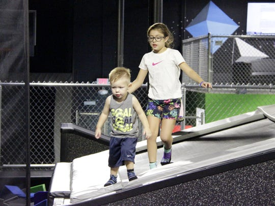 Siblings Jaden Castenada, 3, and Jayla Hernandez, 9, prepare to jump into a foam pit at Visalia's Quantum Leap on Friday afternoon.