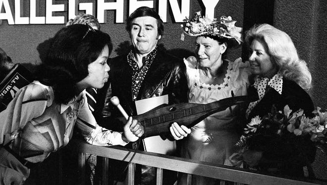 Local Television reporter Oprah Winfrey, left, interviews talk show host Mike Douglas, second from left, and his wife, Genevieve, right, as Minnie Pearl looks on. Douglas is here to tape five talk shows featuring country music stars.