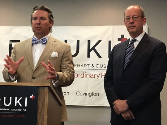Cincinnati lawyers Benjamin Dusing and Ken Hawley appear at an April 2017 news conference to defend Dr. Barbara Temeck, once the deputy chief of staff for the Cincinnati VA Medical Center, against federal drug charges. A federal judge on Friday, July 27, threw out Temeck's conviction for lack of evidence.