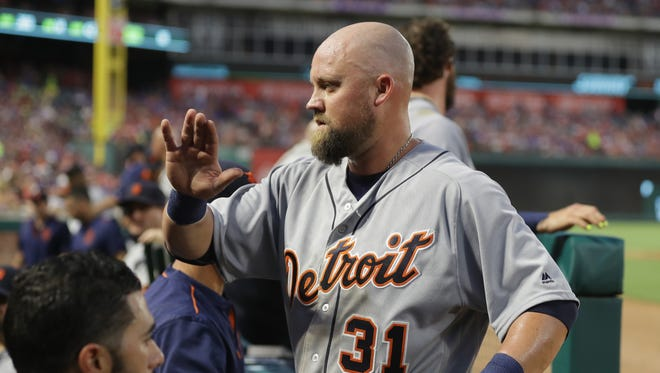 Tigers third baseman Casey McGehee celebrates a run in the fifth inning against the Rangers at Globe Life Park in Arlington Saturday in Arlington, Texas.