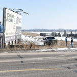 People tend to a well site on the east side of Interstate 25 Monday, March 2, 2015 outside of Johnstown, CO after high pressure ruptured a pop-up valve on one of the oil and gas separators.