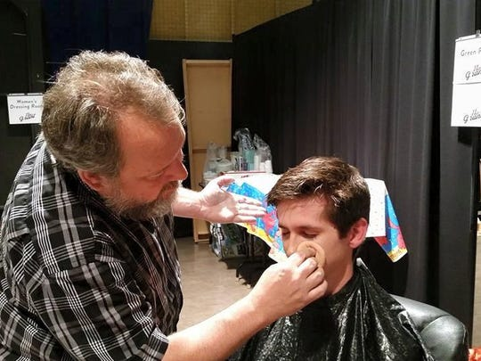 "Chinook Winds clarinetist Chris Mothersole gets makeup before his appearance on ""11th and Grant with Eric Funk."""