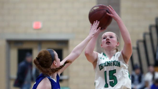 Irvington's Lindsay Halpin (15) goes up for a shot in front of Dobbs Ferry's Camryn McCarthy (10) during the 38th annual Warnock Family Tournament at Irvington High School Dec. 1, 2016.