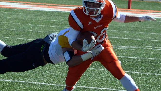 Bulldogs junior slot receiver Ethan Duff tries to break a tackle in the first quarter of a 5A quarterfinals game Saturday, Nov. 21 against St. Pius X. Artesia will face Centennial in the 5A state title game at 1 p.m. Saturday.