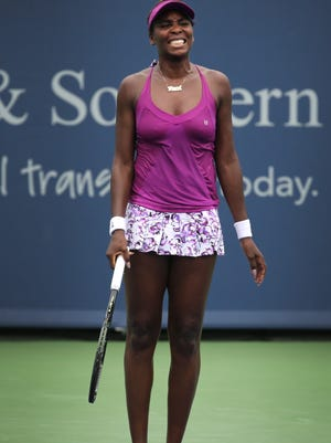 Venus Williams reacts losing a volley to Zarina Diyas in Monday's match at the Western & Southern Open in Mason, Ohio. Williams beat Diyas 7-6(6), 6-4.