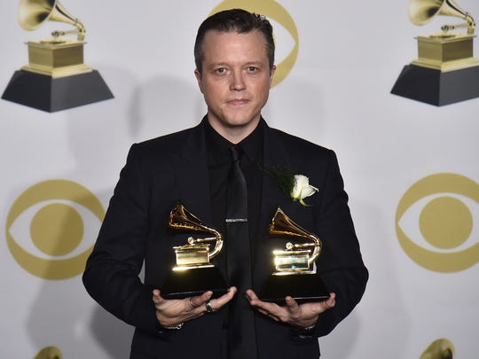 "Jason Isbell poses in the press room with the best American roots song award for ""If We Were Vampires"" and the best Americana album award for ""The Nashville Sound"" at the 60th annual Grammy Awards at Madison Square Garden on Sunday, Jan. 28, 2018, in New York."