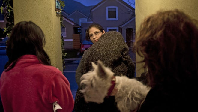 A family in Santiago, Chile, waits outside its house after an earthquake of magnitude 6.4 hit just before 7:30 p.m. ET Aug. 23, 2014.