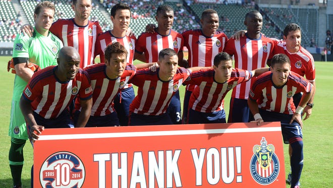 Chivas USA starting line up before the start of the club's final game.
