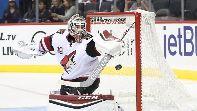 Oct 21, 2016: Arizona Coyotes goalie Louis Domingue (35) reaches for a save during the second period against New York Islanders at Barclays Center.