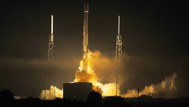 A SpaceX Falcon 9 rocket launches with a pair of communications satellites March 1, 2015.