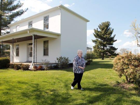 In a 2016 photo, Sister Deborah Harmeling, OSB, walks