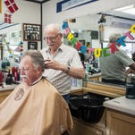 A pair of photographs show a tearful Monte Knutson receiving his first haircut and years later Knutson's son, Jack, giggling in the chair with Don Andersen wielding the clippers for each generation.