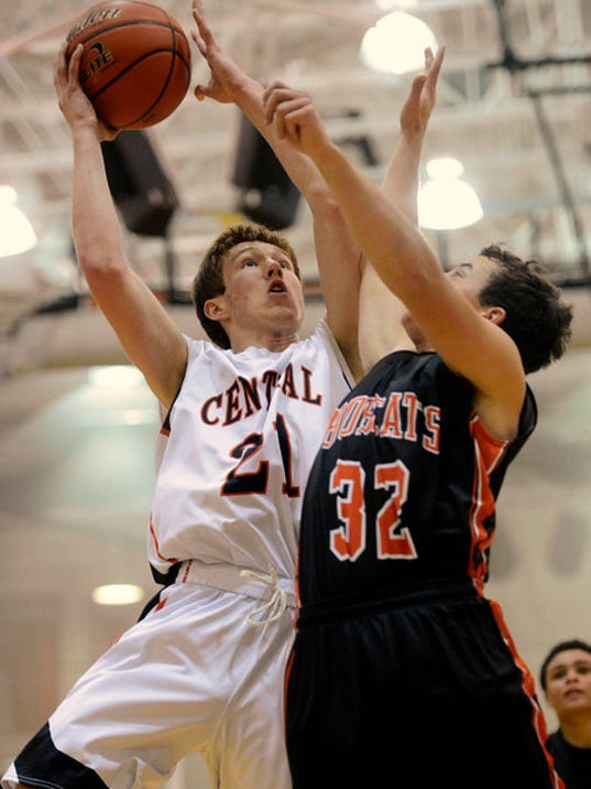 Central York's Sam Saxton shoots against Northeastern's Nick Sprenkle during the boys basketball game at Central York High School Wednesday, December 18, 2013. Central beat Northeastern 65-49. Kate Penn -- Daily Record/Sunday News