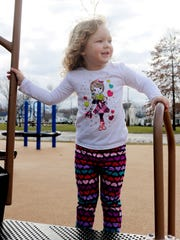 Charlee Thomas, 4, of Port Clinton, enjoys time outdoors at the Flagship Collaborative Play Place on an unseasonably warm Tuesday in January.