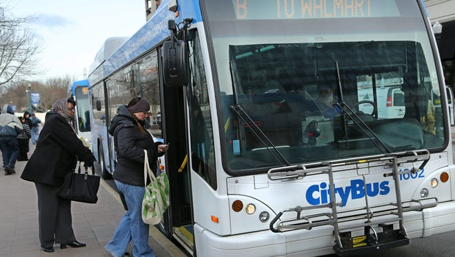 Patrons board a CityBus bus in this 2013 file photo. The bus company plans to change some of the routes and is seeking public input at two hearings on Thursday.