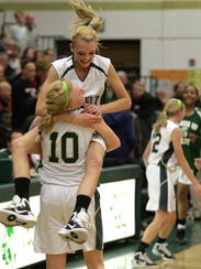 West High's Ally Disterhoft (2) jumps into the arms