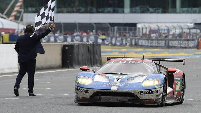 Dirk Mueller crosses the finish line in a Ford GT, to win the LMGTE PRO category of the 84th Le Mans 24-hours endurance race, on June 19, 2016 in Le Mans, France.