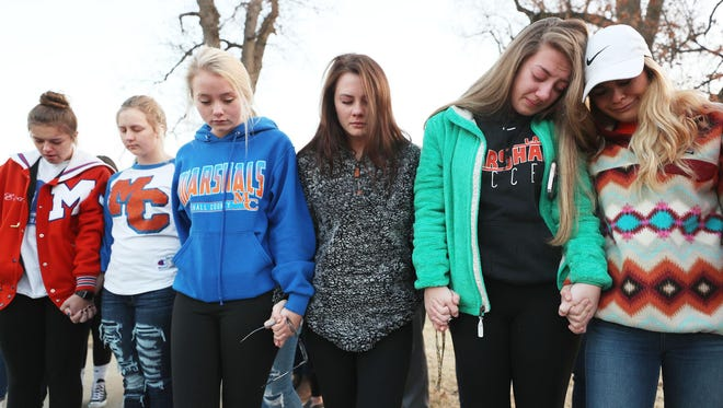 Students from Marshall County High School hold hands during a prayer vigil for their classmates, on Jan. 24, 2018, outside Paducah Tilghman High School. Two students were killed and 18 were injured Tuesday morning at Marshall County High School in Benton, Ky.