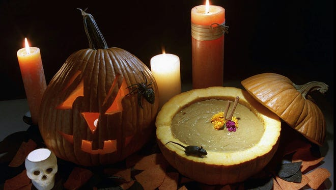 A hollowed-out pumpkin can serve as a festive centerpiece or as a tureen for pumpkin or black-bean soup. (GNS Photo Illustration by Tanya Breen, East Brunswick (N.J.) Home News Tribune)