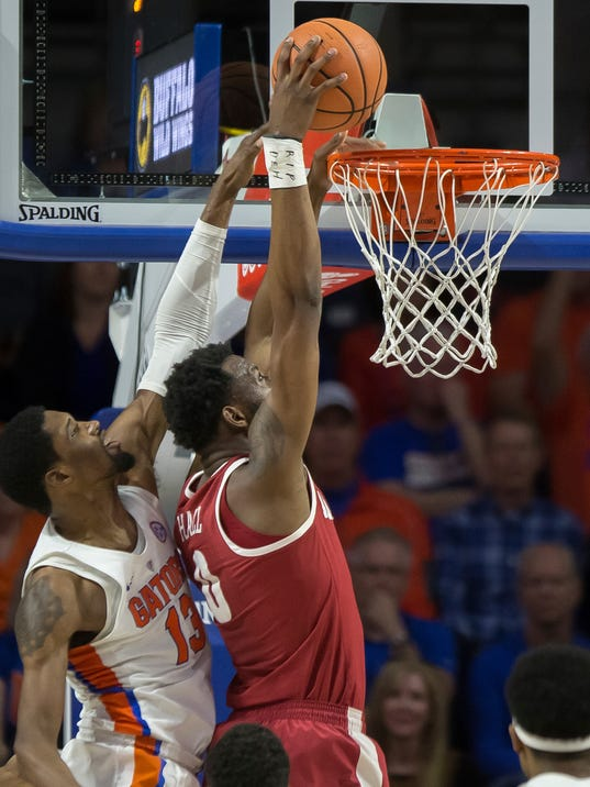 Alabama forward Donta Hall (0) dunks over Florida forward Kevarrius Hayes (13) during the second half of an NCAA college basketball game in Gainesville, Fla., Saturday, Feb. 3, 2018.(AP Photo/Ron Irby)