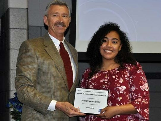 Carmen Arredondo, right, is honored for her work.