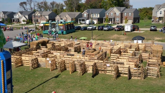 "Thornwilde Elementary's ""Wilde Dads"" group designed a maze for the school's Fall Festival made of shipping pallets and bales of straw."