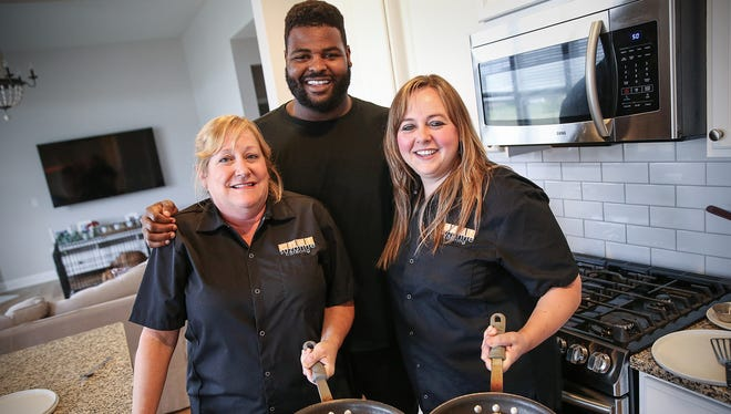 From left, chef Suzanne Rockwell, Indianapolis Colt Johnathan Hankins and chef Christy Rieman pose for a photo at Hankins' home in Carmel, Ind., Monday, Sept. 12, 2017. Hankins is a client of Chef Suzanne Catering, one of many professional athletes the company has served over the years. Chefs Suzanne Rockwell and Christy Rieman prepare and deliver meals to Hankins throughout the week, communicating with the Colts team dietician as needed.