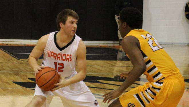 Brother Rice senior guard Davis Feldman (left) looks for an opening against County Day defender Milan Williams.