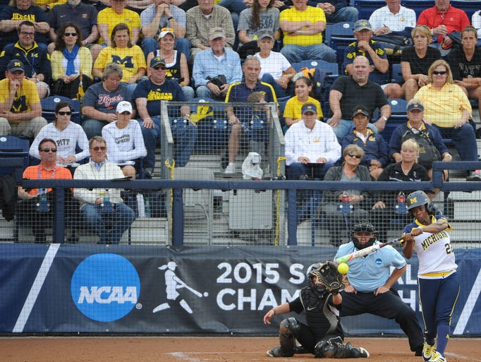 Michigan's Sierra Lawrence hits against Oakland University