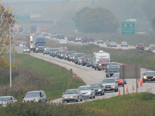 Traffic is rerouted on Atkinson Drive as workers clean up a fuel spill following a crash on the southbound lanes of I-43 on the Leo Frigo Bridge,Thursday, October 2, 2014.
