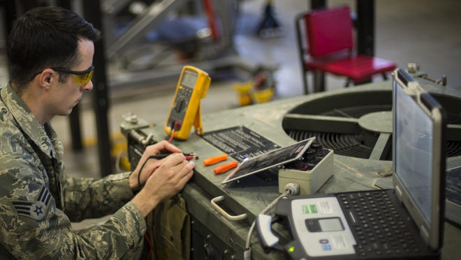 Senior Airman Justin Graham, a 49th Maintenance Squadron Aerospace Ground Equipment technician, repairs an air conditioning unit at Holloman Air Force Base, N.M., on Jan. 12, 2017. Holloman's AGE Airmen perform a wide variety of maintenance duties in support of aircraft maintenance and flying operations. They inspect, test and operate AGE, from air conditioners to complex generators, to ensure equipment serviceability.