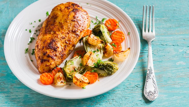 This baked chicken breast with brussels sprouts, onions and carrots is a great example of using multiple basic skills to create a cohesive meal.