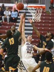 Isaac Spence (22) of Florida Tech fights for a rebound during a game earlier this season.