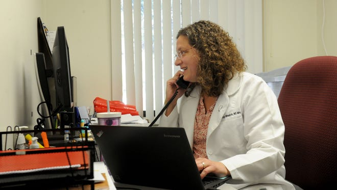 Dr. Sherilyn Wheaton with Primary Medical Group in Ventura works in her office. Star readers voted the family practice doctor and medical director for an urgent care the winner of this year's hardest worker contest.