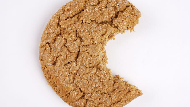 Molasses cookie with a bite gone