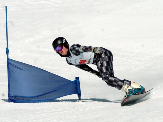 FILE: Andrew Viapiano of South Burlington leans over a slalom gate during snowboard championships on March 11, 2008 at Bromley Mountain in Peru.