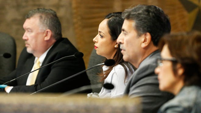 City reps Dr. Michiel Noe, Claudia Ordaz-Perez, Henry Rivera and Cissy Lizarraga sit and listen during a discussion in August.