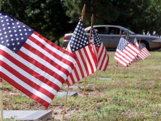 The American Legion Bataan Post 4 members planted 837
