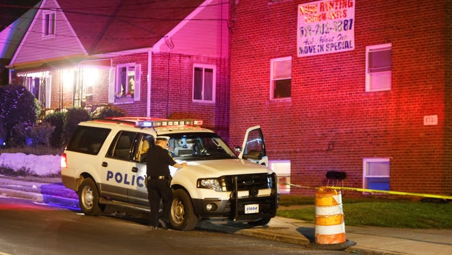 Officers respond to a shooting in the 8100 block of Daly Road in College Hill on Sunday.