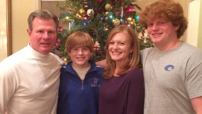 Walker Wilbanks, far right, died Monday, Aug. 25, after complications from a loss of sodium in his body. He became ill during a Jackson Prep football game the Friday night before. He is shown in this undated photograph with his father, David; brother, Landon; and mother, Sheila.