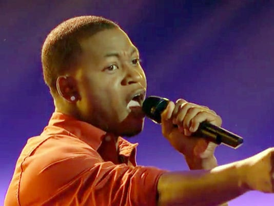Deshawn Washington of Natchitoches reacts to Shakira hitting her button to select him for her team during Monday nightÕs blind auditions episode of the NBC talent show ÒThe Voice.Ó