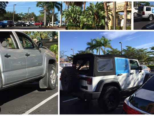 Vehicles with smashed windows, some covered by blue