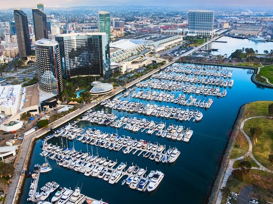 The waterfront of downtown San Diego, California, highlighted by the Marina, Convention Center, and hotels along the shore of the harbor.  I shot this image from an elevation of about 400 feet during a photo flight in a chartered helicopter.