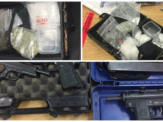 Some of the guns and drugs confiscated during four arrests Tuesday.