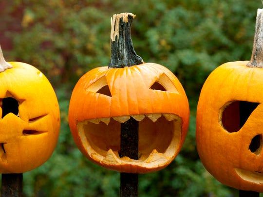 Three spooky Halloween pumpkins