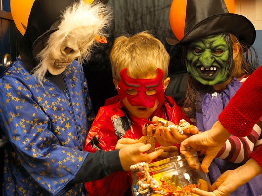 Have children wear bright, reflective costumes and carry a flashlight.