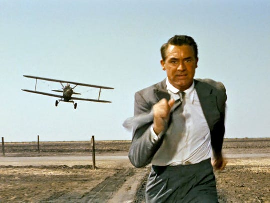 "Cary Grant runs from a murderous biplane in Alfred Hitchcock's Cold War thriller ""North by Northwest"""