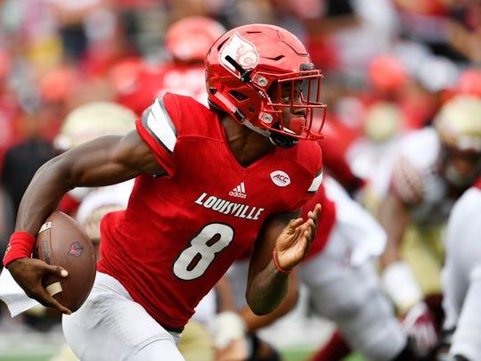 Louisville quarterback Lamar Jackson (8) runs the ball against Florida State on Sept. 17.