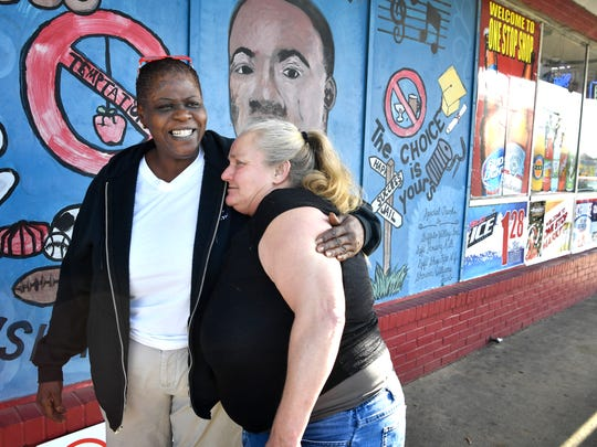 Damita Utley hugs her friend Lanette Spicer when they meet.Utley is worried about the violence in her neighborhood and has formed a group: Stop the Violence in Springfield.  Friday Dec. 1, 2017, in Springfield, TN